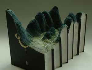 "Part of the ""El amor por las montañas"" series by Guy Laramee, carved books & mixed media"
